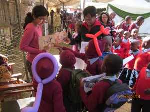 The author raises awareness on cheetah conservation at an agricultural show.  Photo courtesy of the author.