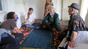 Our team interviews a local community leader in Takob who had helped to kill a snow leopard years ago after it killed several of his neighbor's sheep. Photo courtesy of the author.