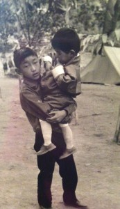Benji holds his younger cousin, the Fourth King of Bhutan. Photo courtesy of Dasho Benji.