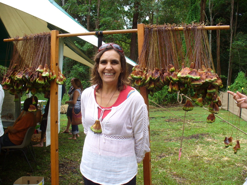 Beverly Hand, organizer of the Bunya Dreaming gathering, stands in front of welcome necklaces made of bunya seeds