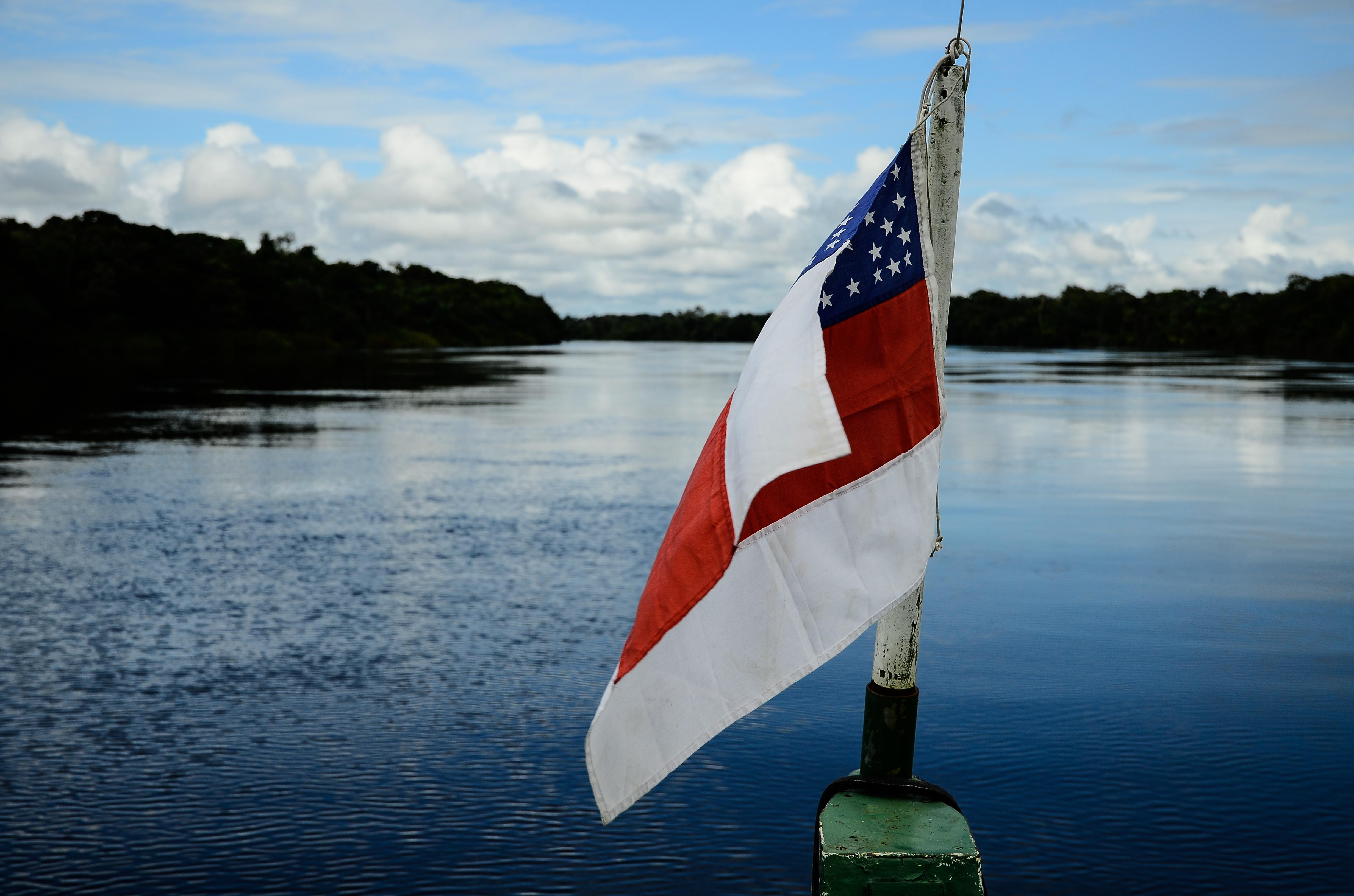 Amazonas State Flag on boat into Rio Unini.