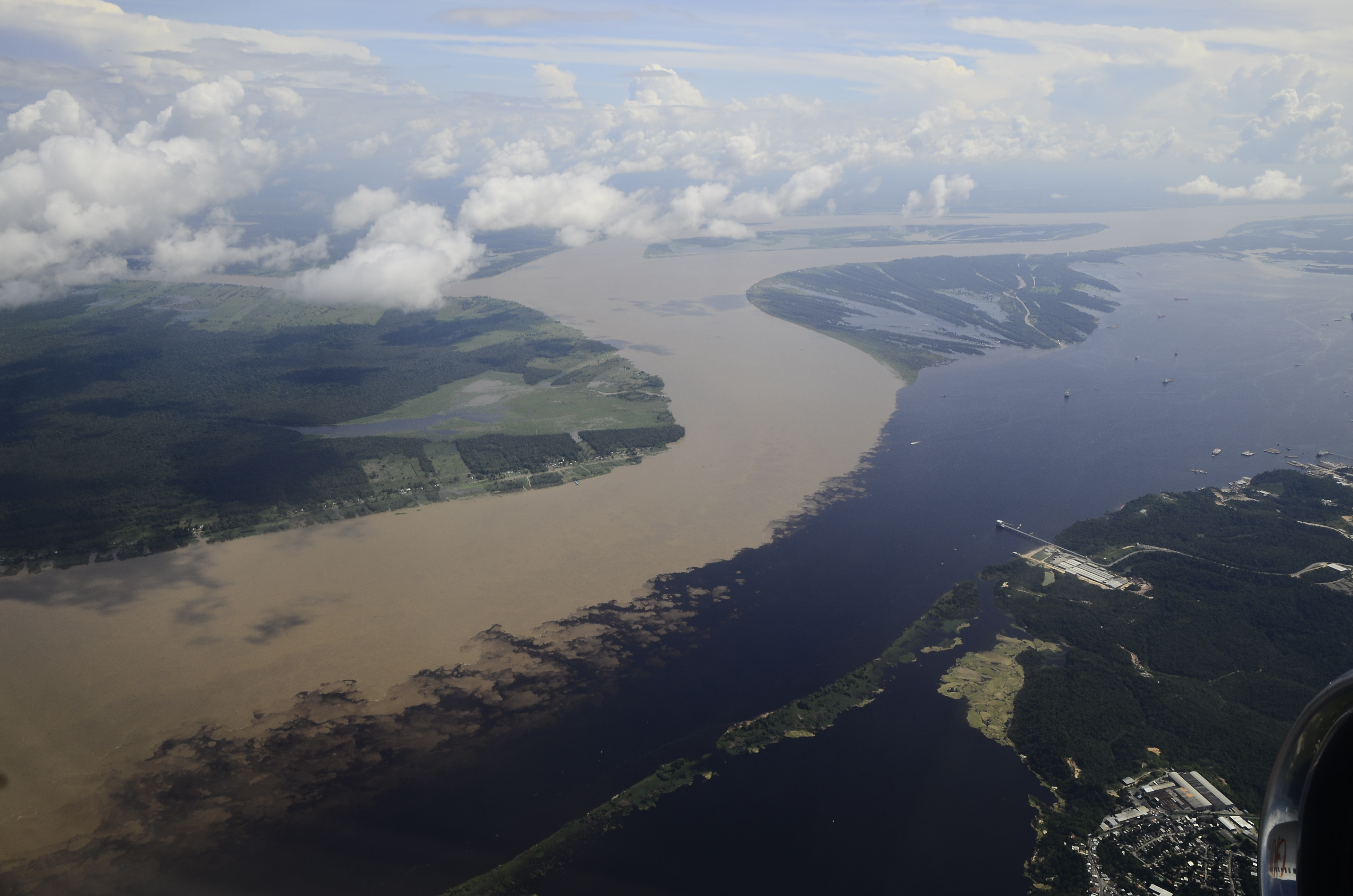 Meeting of the coffee-colored Rio Negro and cream-colored Rio Solimões.