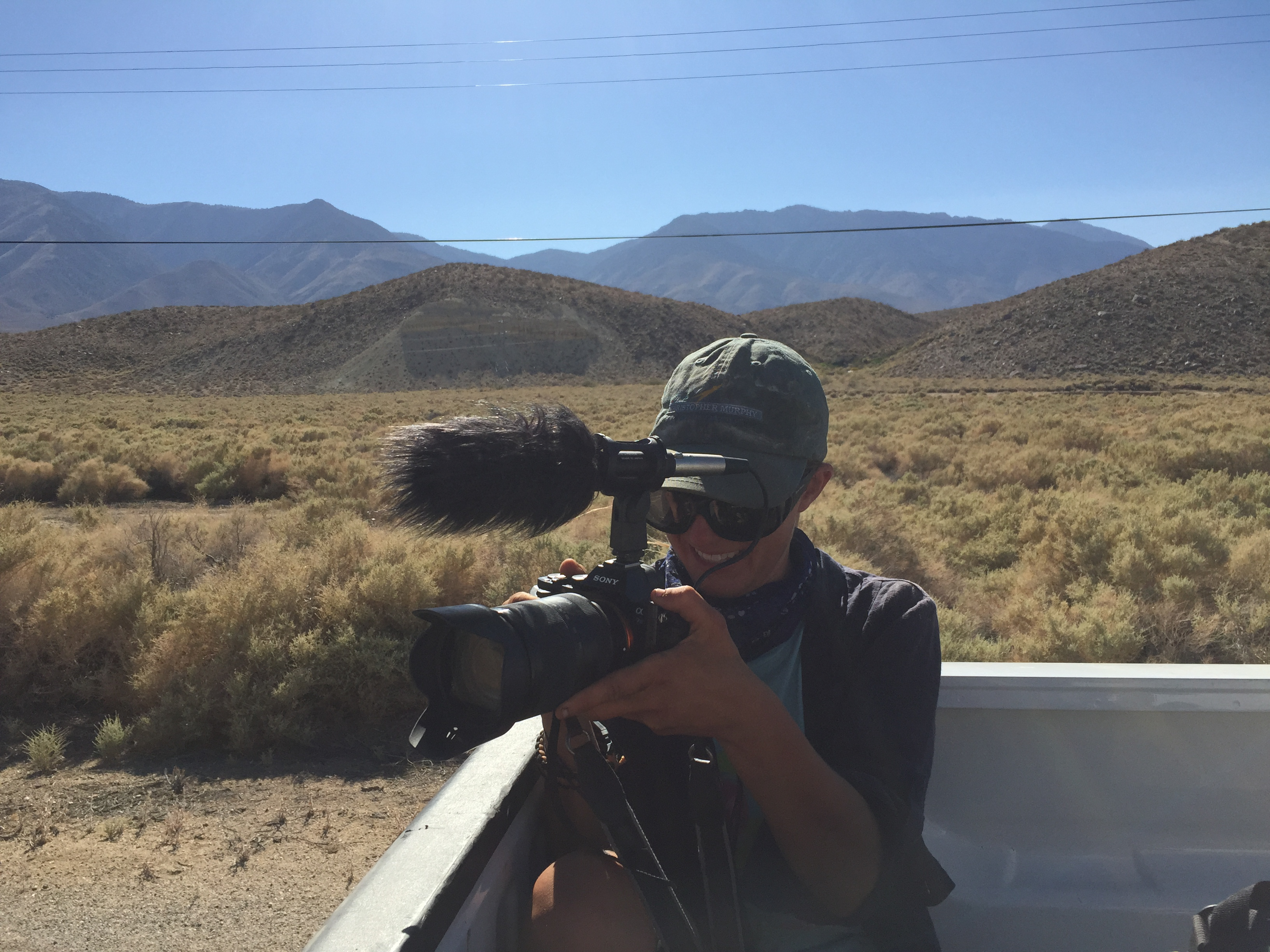 Sam, filming the aqueduct with the eastern Sierras in the background.