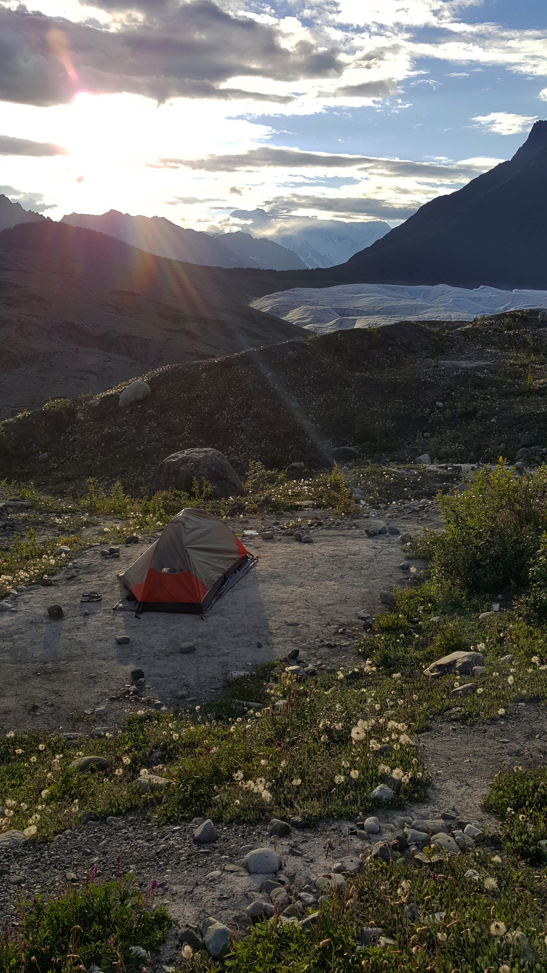 My tent overlooking the Root Glacier and St. Elias Mountain Range. The sun set at about midnight and rose at 4AM, merging dusk and dawn and painting the night sky a light pink.